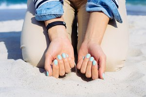Woman with blue nail polish