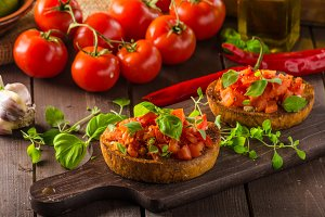 Italian bruschetta with roasted tomatoes and garlic
