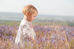 Child girl in meadow
