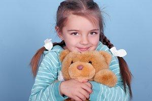Kid girl with teddy bear