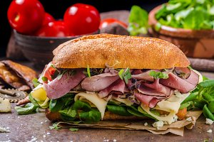 Sandwich with ham and cheese, lettuce