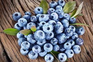 Blueberries over old wooden table