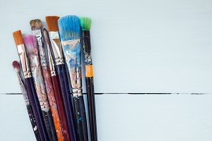 Paint brushes on white background