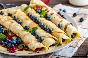 Pancakes with jam and blueberries