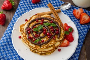 Cinnamon pancakes with chocolate sauce and berries