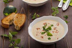 Creamy zucchini soup with chilli and oregano