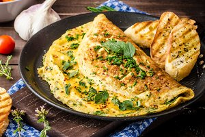 Herb omelette with chives and oregano sprinkled with Herb omelette with chili flakes