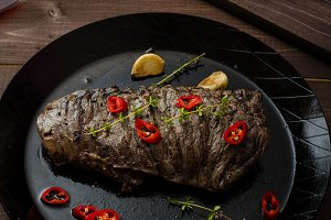 Beef steak with herbs and chilli, product photo