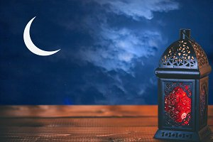 The Muslim feast of the holy month of Ramadan Kareem. Beautiful background with a shining lantern Fanus. Free space for your text.