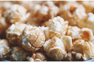 Caramelized popcorn background. Macro shot. Selective focus.