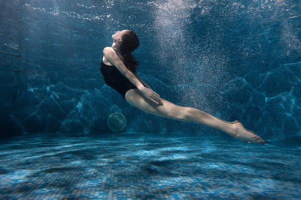 Woman is swimming at the bottom of…
