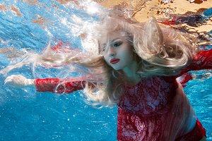 Surrealism is a woman underwater.