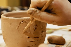 Ceramist is modeling clay pot or vase bowl
