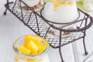 Breakfast dessert with bran flakes, plain yogurt and mango
