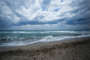 sand beach with turquiose sea and clouds