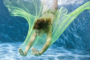 Woman dives with a fabric.