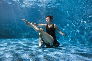 Dancing woman underwater.