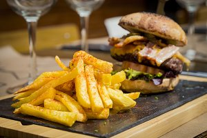 Traditional plate of chips and burger sandwich