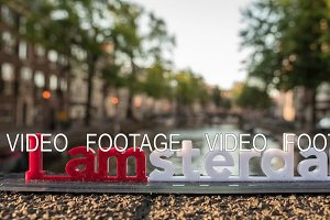 Timelapse of city and Amsterdam slogan