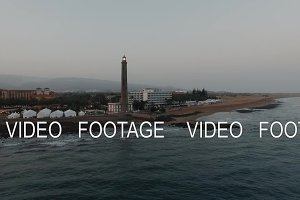 Gran Canaria coastal resort with lighthouse, aerial