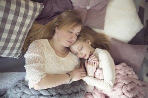 mom and her daughter teen sleeping