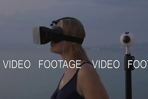 Woman in VR-headset and 360 degree camera