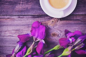 Purple irises and cup of coffee