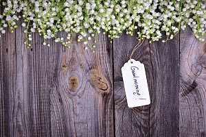Gray wooden background with tag