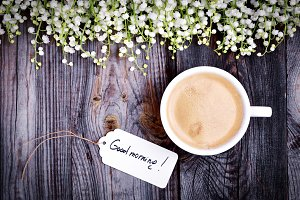 Wooden background with cup