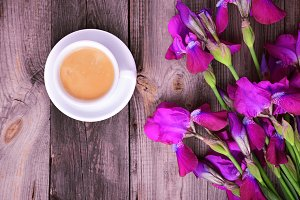 Cup of  coffee and purple irises