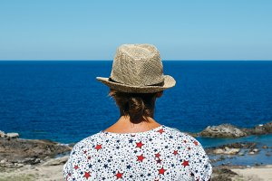 Woman wearing hat at seaside