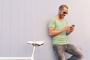 Handsome man using mobile.