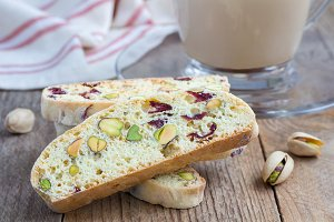 Biscotti with cranberry and pistachio with cup of coffee latte, closeup
