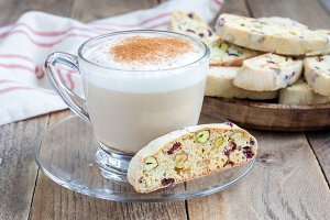 Biscotti with cranberry and pistachio, cup of coffee latte
