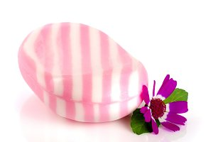 White pink striped soap with a flower isolated on white background