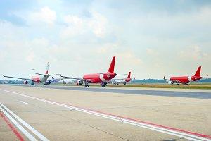 Airport runway full of planes