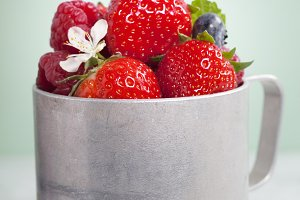 Fresh berry in old aluminum mug