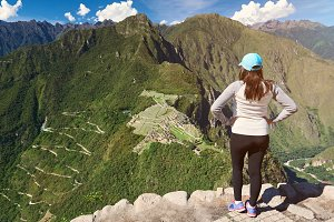 Young girl look on Machu Picchu