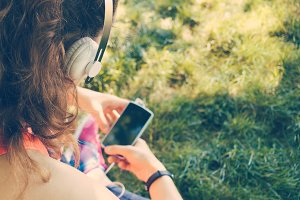 Girl in headphones listen to music