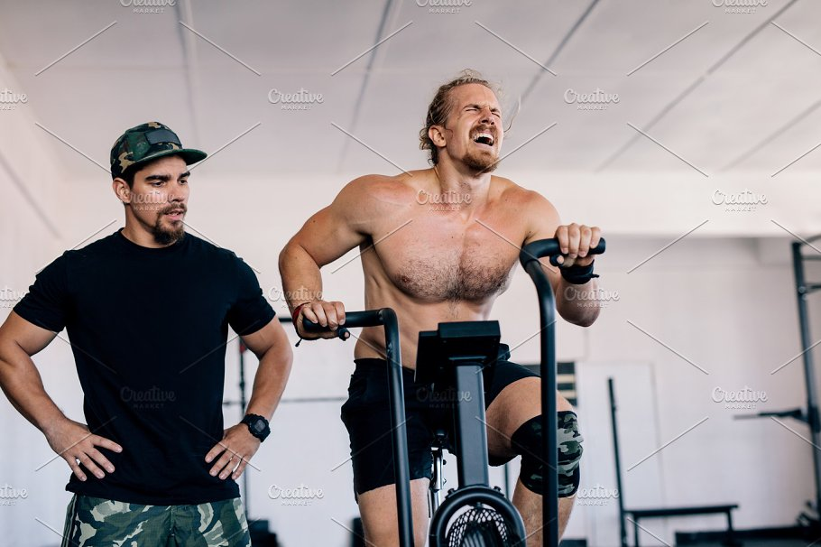 Bodybuilder Spinning Stationary Bike Sports Photos Creative Market