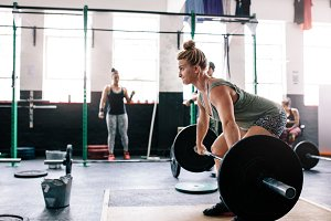 Muscular woman weight lifting