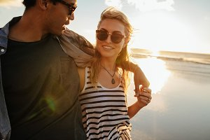Woman with boyfriend on beach.