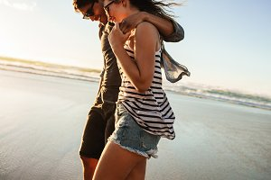 Couple strolling together on beach