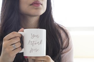 Woman holding blank mug mockup