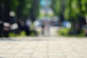 Blurred summer park alley background