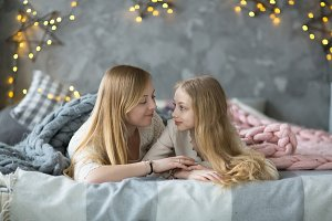 Mom and daughter with long blond