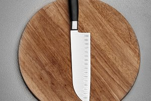 kitchen knife lying on an old cutting board