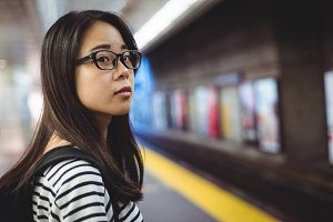 Young woman waiting for train