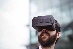 Businessman using virtual reality headset