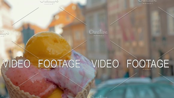 Slow Motion View Of Unfocused Cityscape On The Background And Then Seen Ice Cream Balls In The Waffle Cup Prague Czech Republic